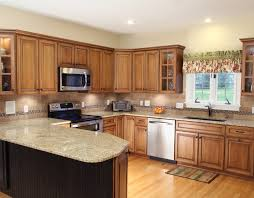 kitchen with giallo ornamental granite countertops