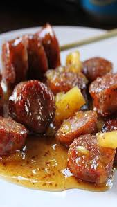 y and sweet smoked sausage the sausage is cut into bite sized pieces and browned then served in a sauce of pineapple brown s