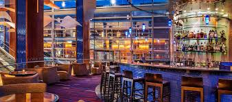 lobby bar seating with large glass windows lobby bar view of harbor baltimore inner harbor