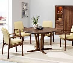 traditional danish round dining table shown in walnut