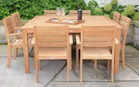 square dining table with teak chairs