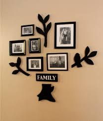 square black stained wooden family photos frame design on brown painted wall together black tree theme