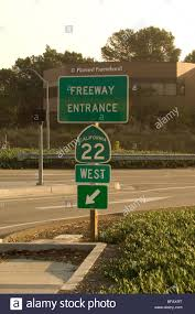 sign for the 22 freeway garden grove freeway in orange ca with the planned pahood building visible in the background