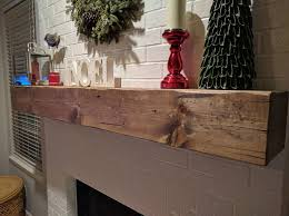 picture of wood beam fireplace mantel