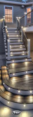 Create a little drama on your deck with deck lighting installed on stair  risers and railing