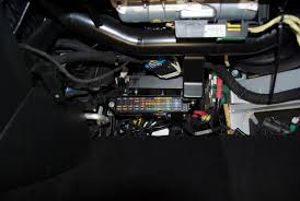sound in motion boston s best mobile entertainment design custom brackets were fabricated in order to relocate two computers and the fuse box out of the passenger foot well and up behind the glove box