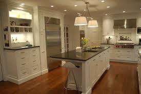 white drum shade ceiling hanging lamp over rectangle kitchen island using black granite countertop