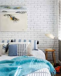 white brick wall with artistic wall painting