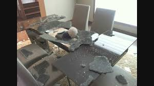 a glass dining room table top explodes