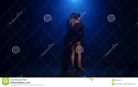 Tango Dancing Couple Of Professional Elegant Dancers On Blue