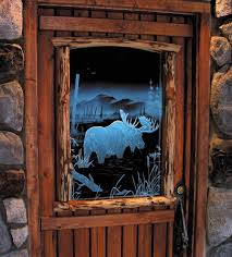 illuminated carved etched glass moose door