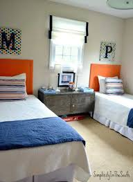 For privacy's sake, this family chose to divide a shared bedroom with an inconspicuous pocket door. Room Reveal Our Two Youngest Boys Shared Bedroom Simplicity In The South