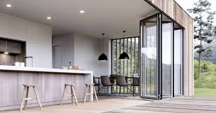 exterior of a modern two y extension with sliding doors leading out to a terrace
