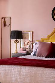 farrow and ball calamine paint in bedroom with accents of burdy and blush pink