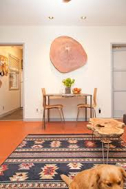 large wood slice wall art that becomes an accent table via apartment therapy