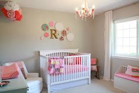 outstanding baby girl room with cream wall paint and crystal chandelier idea