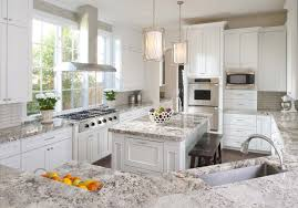 white granite countertops with oak cabinets