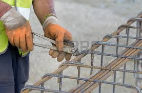 reinforcing rebar close up of construction worker hands working with pincers on fixing steel rebar rebar worker