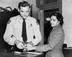 rosa parks biography facts com rosa parks being fingerprinted in montgomery alabama 1 1955