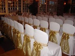 gold ribbon white chair cover patterns wedding decorative plants in brick building
