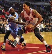 derrick rose 2014. Brilliant 2014 Oct 13 2014 Chicago IL USA Chicago Bulls Guard Derrick Rose 1 Is  Defended By Denver Nuggets Ty Lawson 3 During The First Quarter At  In 2014 U