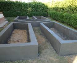 raised garden bed made of block and covered with concrete