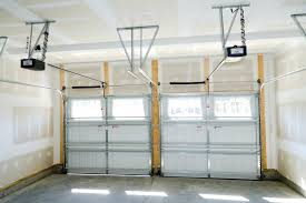 average cost to replace a garage door mhfdemo within how much do garage door springs