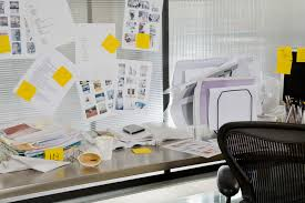 124 6 adult career focus at work ss 124 messy desk ts 80617517 all papers are labeled a sticky note of what needs to be done them