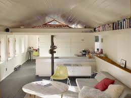 pretty small apartment deck interior design ideas with grey wooden floor and white wooden ceiling also round coffee table plus modern sofa including small