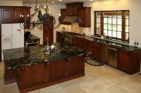 carrara black granite backsplash and kitchen island decor with red cherry wood cabinet drawer plus freestanding cooking range