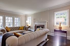 view in gallery a very stylish and inviting beige chesterfield sofa in a traditional living room