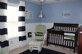 the bedding is the alligator madras nursery bedding from pottery barn i loved the plaid per and crib skirt and the wide blue and white striped quilt and