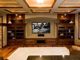 Captivating Finished Basement Idea with Huge Wooden Shelf Units and Wall  Mounted LED Tv and Light-brown Wall Paint Color also White Shag Area Rug  and ...
