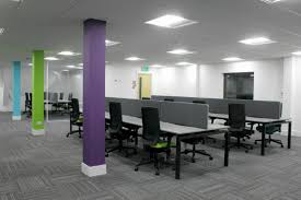 office interior designers london. Three Workplace Pillars Painted In Purple Blue And Lime By An Office Interior Design Company From Designers London