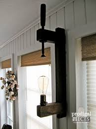 upcycled wooden farmhouse clamp as wall sconce by prodigal pieces prodigalpieces com