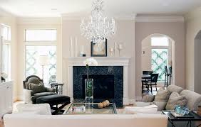 houston small crystal chandelier living room traditional with beige fireplace mantel rustic artificial plants and trees