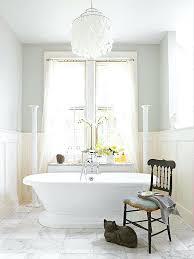 light over tub light filled bathroom with shell chandelier over bathtub