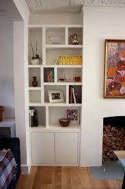 Living Room Cupboards Designs Contemporary Alcove Cabinet With Zig Zag Floating Shelves