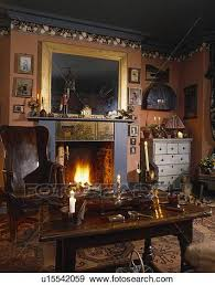 gilt framed mirror over blue fireplace
