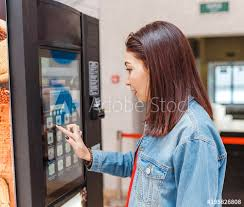 Woman Vending Machine Mesmerizing Woman Buying Coffee From Automatic Vending Machine Buy This Stock