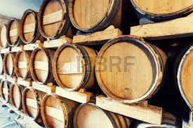 stacked oak barrels maturing red wine. Barrels Stacked In A Wine Cellar Photo Oak Maturing Red N