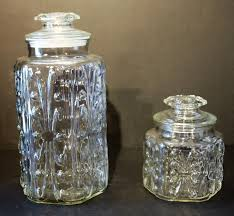 set of 2 vintage clear glass canisters w dots curls 12 6 3 4