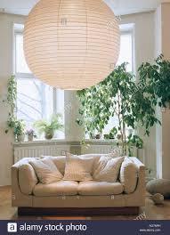 "Large Japanese Paper Lantern Above White Sofa And ""ficus Benhamina  throughout Bay Window Sofas"