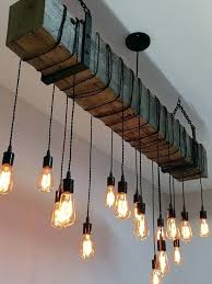 hanging barn lights reclaimed barn beam light fixture with hanging brackets and wrapped led bulbs rustic
