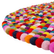 pinocchio round multi coloured pom pom rug