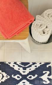preppy coastal bathroom makeover navy ikat rug touches of c