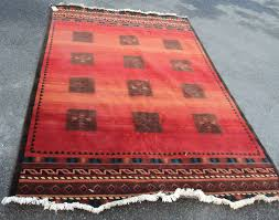 lot 1264 a louis de poortere marco polo rug with simple geometric patterns on a