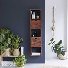 the wall mounted teak shelf unit