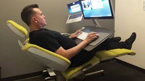 altwork ceo and cofounder che voigt demonstrates his new reclining work station