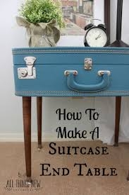 How to turn a vintage suitcase into an end table. Just add legs!